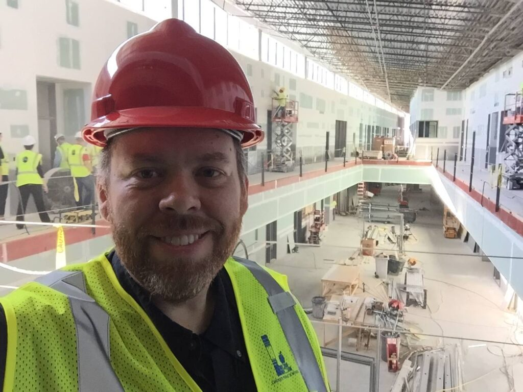 Don inspects the construction of the Career Academy.